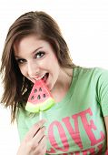foto of licking  - A Charming young woman licks tasty sugar candy - JPG