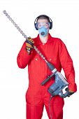 picture of hammer drill  - a man in overalls holding a hammer with a huge drill - JPG