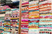 stock photo of no clothes  - Indian colored clothes on the shelves of a store in Dubai - JPG