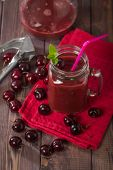 image of cherries  - homemade cherries drink with fresh cherry on wooden table - JPG