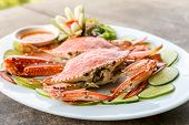 foto of cooked crab  - steam red crab with lemon lime and spicy seafood sauce - JPG