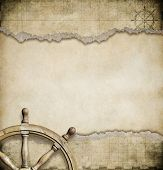 stock photo of steers  - old steering wheel and torn nautical map background - JPG