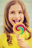 pic of lollipops  - Cheerful young girl with a lollipop - JPG
