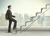 image of climb up  - Business man climbing up on hand drawn staircase concept on city background - JPG