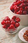 stock photo of cherries  - Sweet Cherry in Bowl on Rustic Table Ripe Fresh Wild Cherries Fruit Vintage Retro Tone - JPG