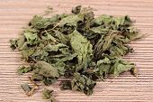 picture of nettle  - Heap of healthy dried nettle on wooden table concept for healthy nutrition and herbalism - JPG