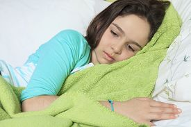 pic of saddening  - A Young sad woman lay on bed - JPG