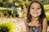 stock photo of young girls  - Cute little girl playing outside - JPG