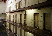 pic of infraction law  - Interior view of floors of prison cell blocks.