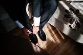 Man Wearing Luxury Patent Leather Shoes On Sunlight With Shadows. Gathering Of Groom On Wedding Day. poster