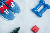 Christmas Sport Composition With Shoes, Dumbbells And Red Gift Box poster