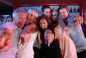pic of night-club  - Group Of People Having Fun In Busy Bar - JPG
