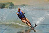 Beautiful Woman Waterskiing On A Lake
