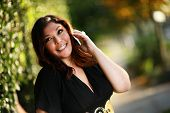 foto of beautiful women  - Beautiful plus size model outdoors - JPG