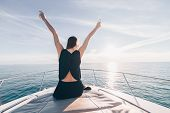 Happy Rich Girl Enjoys Vacation, Raised Her Hands Up, Enjoys The Sea View And The Sun poster