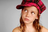 pic of newsboy  - Freckle faced young girl looking up wearing pink plaid cap - JPG