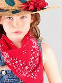 stock photo of young girls  - Pretty young girl in overalls with hat and bandana - JPG
