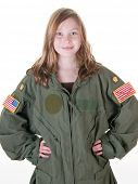 stock photo of bomber jacket  - young girl wearing flight suit too big for her as part of her dream to fly - JPG
