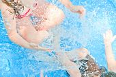 stock photo of swimming pool family  - Young kids having fun in pool - JPG