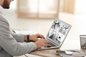 Man Using Laptop For Monitoring Cctv Cameras At Table Indoors. Home Security System poster