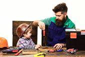 Father&son In Workshop. Handcrafting, Repair, Craftsman. Kid Boy Play In Handyman. Cute Kid Explorin poster