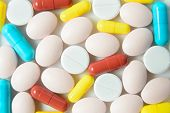 Pile Of Assorted Medicine Pills And Capsules, Macro Pharmaceutical Background. Top View. poster