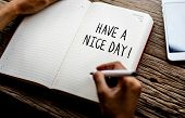 Phrase Have a nice day on a notebook poster