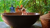 Happy Baby Boy Have Fun In Bathtub. Joyful Child Take Bath In Outside Bathroom On Open Veranda With  poster