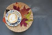 Autumn Concept Coffe Cup Maple Leaves Wicker Table Fall Season Cozy Comfort Home Flat Lay Copy Space poster