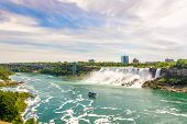 View At The Rainbow International Bridge Over Niagara River With American Falls And Bridal Veil Fall poster