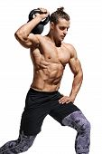 Sportive Man Workout With Kettlebell Doing Lunges. Photo Of Young Man With Good Physique Isolated On poster