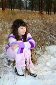 picture of american indian  - Young brunette teen in the field after the snowfall - JPG