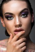 Thoughtful Girl Posing With Glamor Makeup And Glitter On Body, Isolated On Grey poster
