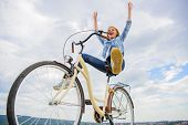 Girl Rides Bicycle Sky Background. Freedom And Delight. Woman Feels Free While Enjoy Cycling. Most S poster
