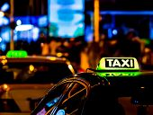 Taxi In The City At The Dark. Car With Glowing Taxi Sign Moving In The Night poster