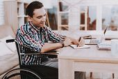 Young Disabled Man On Wheelchair Working At Home. Man On Wheelchair. Disabled Guy. Checkered Shirt.  poster