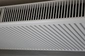 White Radiator. Heating Radiator. New Heating Radiator On A Wall Background. poster