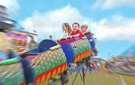 image of amusement park rides  - Happy kids on rollercoaster at amusement park - JPG