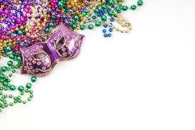 image of mardi gras mask  - Mardi gras mask and beads in pile - JPG
