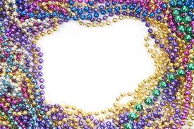 stock photo of mardi-gras  - holiday or mardi gras beads makingframe - JPG