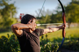image of longbow  - Young archer training with the  bow - JPG