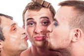 foto of transvestites  - Close up of three cute transvestites kissing isolated on white background - JPG