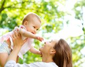 picture of joy  - Beautiful Mother And Baby outdoors - JPG