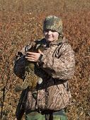picture of ringneck  - A young hunter holding a Rooster Pheasant - JPG