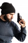 image of beanie hat  - a bearded criminal or an undercover cop with a pistol and wearing a beanie hat isolated over white - JPG