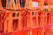 image of inari  - Small praying torii cards at the Fushimi Inari Shrine in Kyoto Japan - JPG