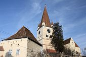 picture of fortified wall  - Medieval fortified church surrounded by walls - JPG