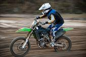 picture of motocross  - Motocross bike in a race - JPG