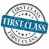 foto of first class  - First class blue round grungy stamp isolated on white background - JPG