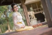 stock photo of polite girl  - Beautiful Thai girl in Thai traditional costume - JPG